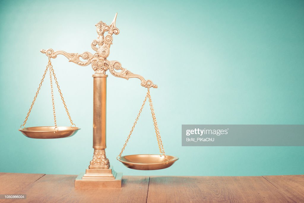 Bronze law scales on table. Symbol of justice. Retro old style filtered photo : Stock Photo