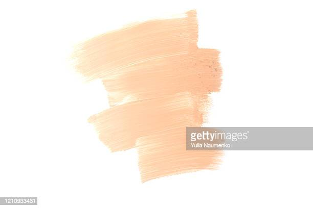bronze makeup smear isolated on white background. liquid foundation makeup texture. foundation strokes or liquid powder on a white background. - beige stock-fotos und bilder
