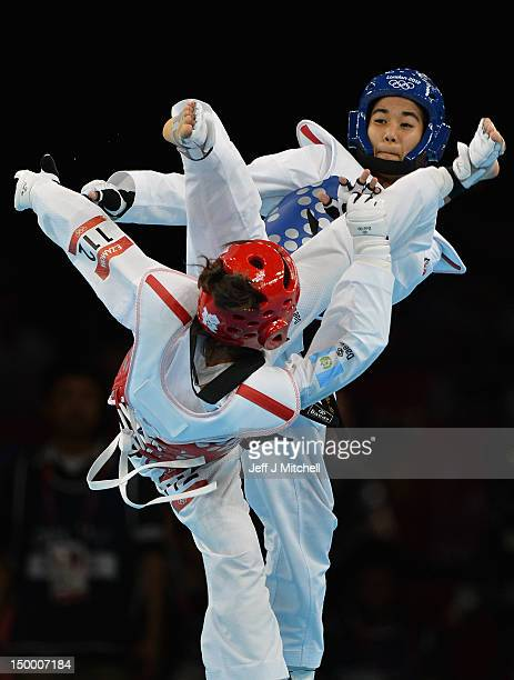 Bronze medal Elizabeth Gordillo Zamora of Guatemala competes against Chantip Sonkham Thailand during the womans 49kg Taekwondo Bronze medal match on...
