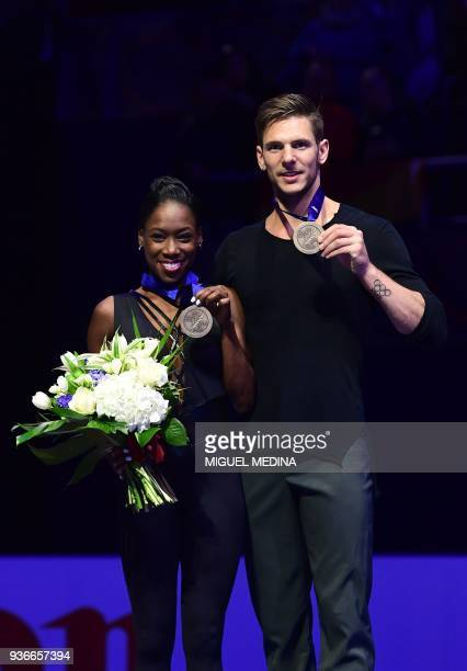 Bronze medal France's Vanessa James and Morgan Cipres pose on the podium during the medal ceremony on March 22 2018 during the Pairs Free Skate at...