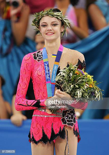Bronze medal winner Anna Bessonova of Ukraine stands on the podium during the medal ceremony for rhythmic gymnastics on August 29 2004 during the...