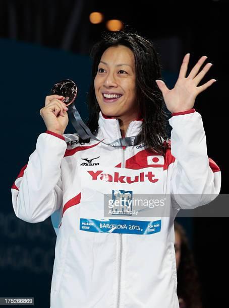 Bronze medal winner Aya Terakawa of Japan celebrates on the podium after the Swimming Women's Backstroke 50m Final on day thirteen of the 15th FINA...