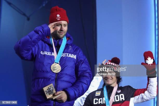 Bronze medal winner Billy Morgan of Great Britain and gold medal winner Sebastien Toutant celebrate during the medal ceremony for Snowboard Men's Big...