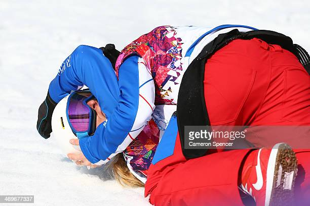 Bronze medal winner Chloe Trespeuch of France celebrates with a teammate after the Ladies' Snowboard Cross Finals on day nine of the Sochi 2014...