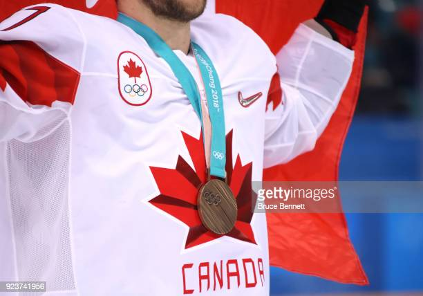 Bronze medal winner Cody Goloubef of Canada celebrates after defeating Czech Republic 64 during the Men's Bronze Medal Game on day fifteen of the...