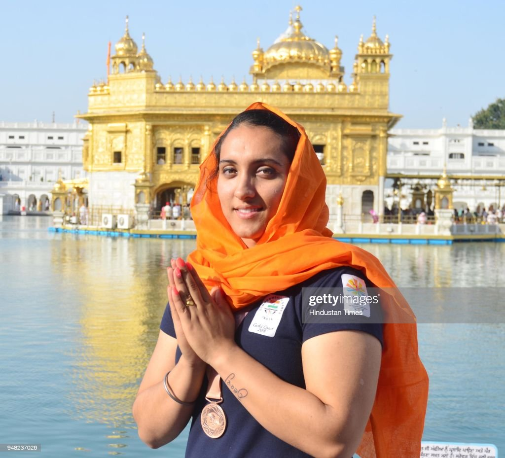 Bronze medal winner Discus Thrower Navjeet Kaur Dhillon paying obeisance at Golden Temple on April 18 2018 in Amritsar India