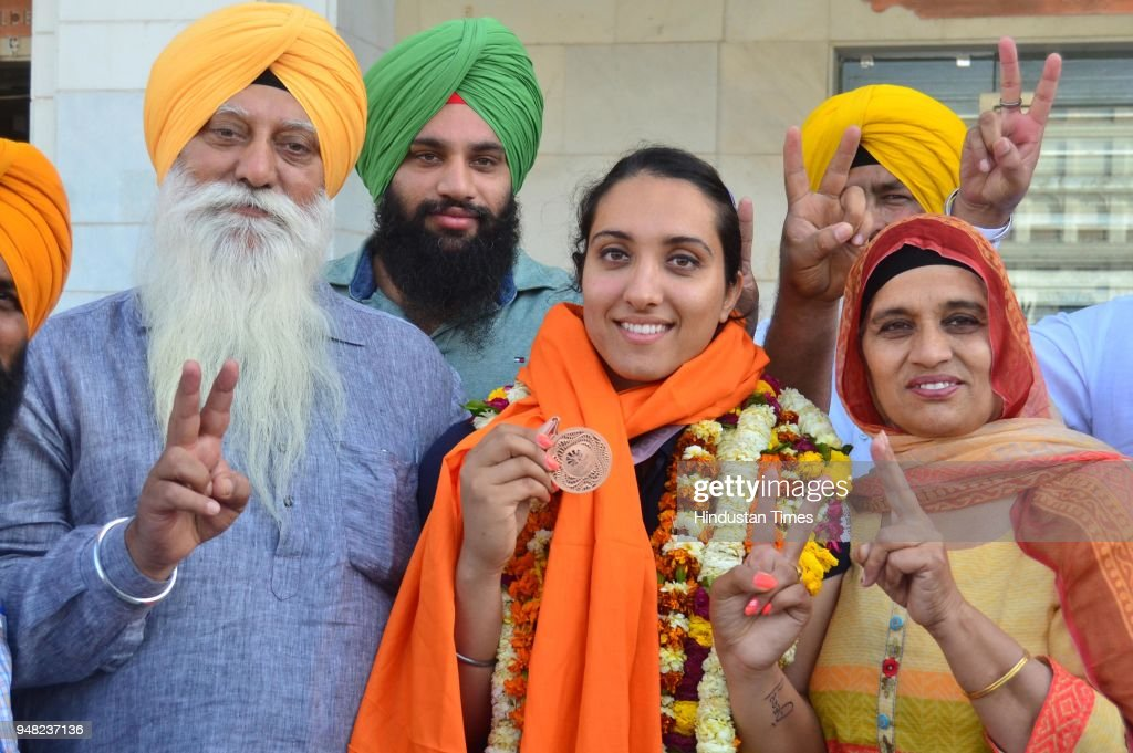 Bronze medal winner Discus Thrower Navjeet Kaur Dhillon with her mother Kuldeep Kaur father Jaspal Singh brother Jasdeep Singh on April 18 2018 in...