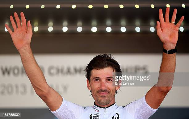 Bronze medal winner Fabian Cancellara of Switzerland poses on the podium after the Elite Men's Time Trial, from Montecatini Terme to Florence on...
