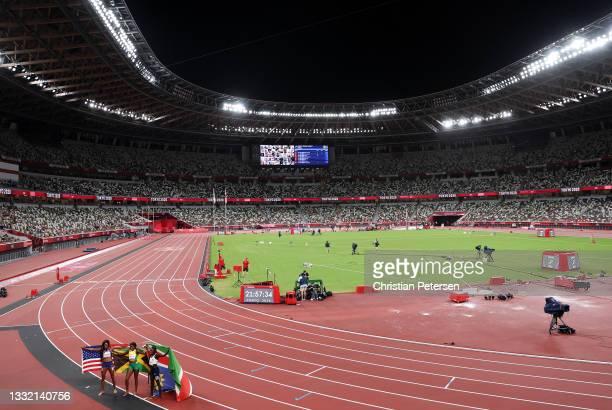 Bronze medal winner Gabrielle Thomas of Team United States, gold medal winner Elaine Thompson-Herah of Team Jamaica and silver medal winner Christine...