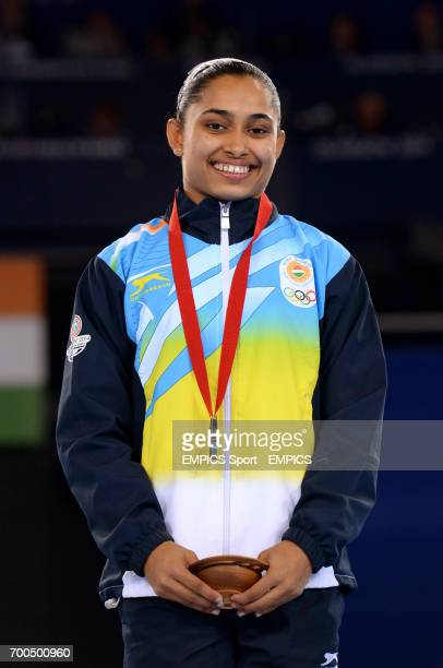 Bronze medal winner India's Dipa Karmakar on the podium following the Women's Artistic Gymnastics Vault Final at the SSE Hydro during the 2014...