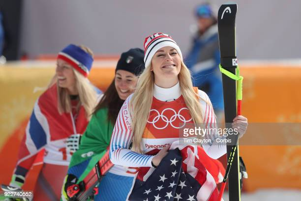 Bronze medal winner Lindsey Vonn acknowledges her supporters in the crowd during the presentation after the Alpine Skiing Ladies' Downhill race at...