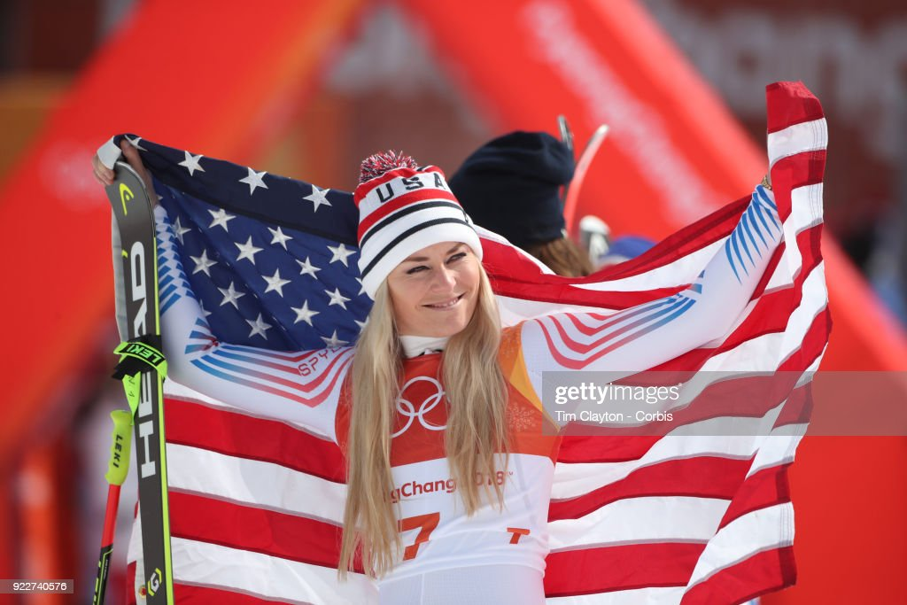 Bronze medal winner Lindsey Vonn #7 acknowledges her supporters in the crowd during the presentation after the Alpine Skiing - Ladies' Downhill race at Jeongseon Alpine Centre on February 21, 2018 in PyeongChang, South Korea.