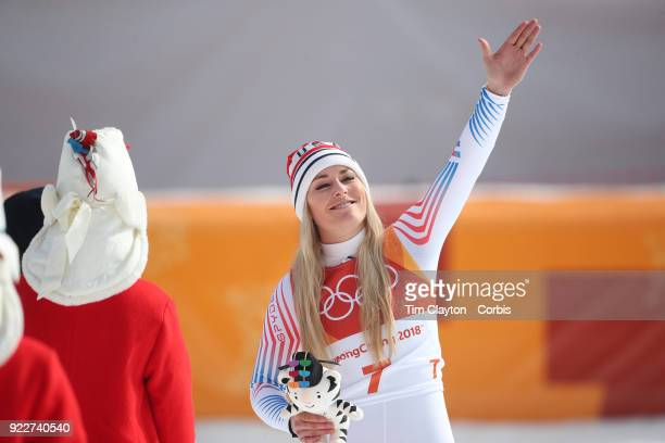 Bronze medal winner Lindsey Vonn blows a kiss to her supporters in the crowd during the presentation after the Alpine Skiing Ladies' Downhill race at...
