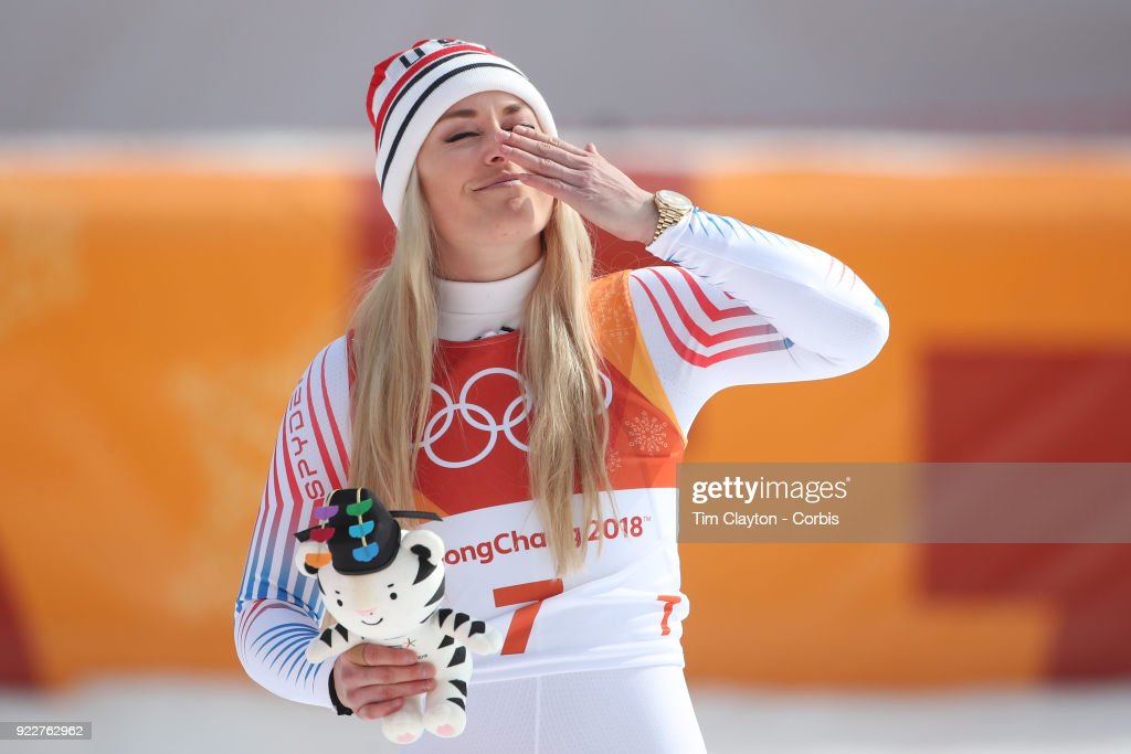 Bronze medal winner Lindsey Vonn #7 blows a kiss to her supporters in the crowd during the presentation after the Alpine Skiing - Ladies' Downhill race at Jeongseon Alpine Centre on February 21, 2018 in PyeongChang, South Korea.