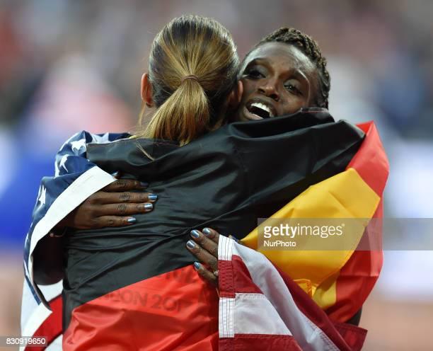 Bronze medal winner PamelaDutkiewicz of Germany and silver medal winner DawnHarper Nelsonof USA celebrating after the100 meter hurdles final in...