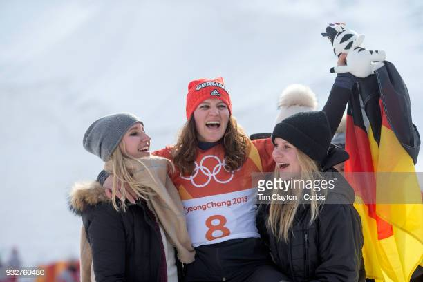 Bronze medal winner Ramona Theresia Hofmeister from Germany celebrates after the Ladies' Snowboard Parallel Giant Slalom competition at Phoenix Snow...