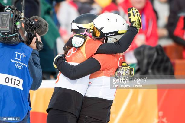 Bronze medal winner Ramona Theresia Hofmeister from Germany and silver medal winner Selina Joerg from Germany embrace during the Snowboarding...