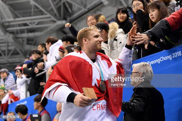 Bronze medal winner Rob Klinkhammer of Canada celebrates with fans after defeating Czech Republic 64 during the Men's Bronze Medal Game on day...