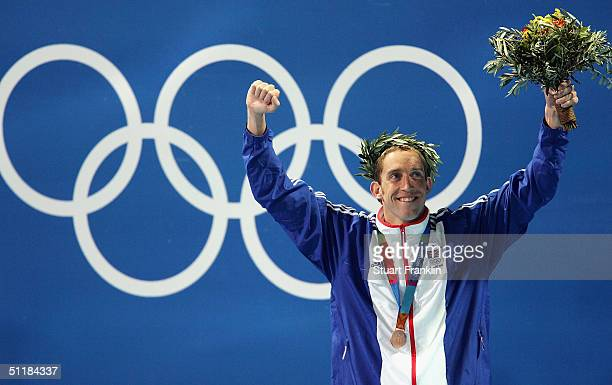 Bronze medal winner Stephen Parry of Great Britain celebrates his medal for the men's swimming 200 metre butterfly event on August 17 2004 during the...
