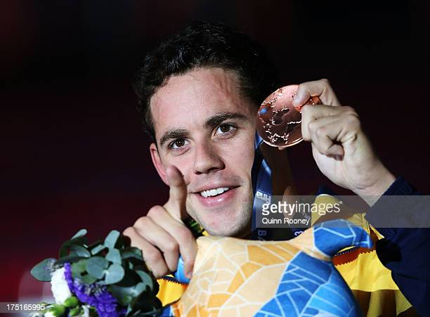 Bronze medal winner Thiago Pereira of Brazil celebrates on the podium after the Swimming Men's Individual Medley 200m Final on day thirteen of the...