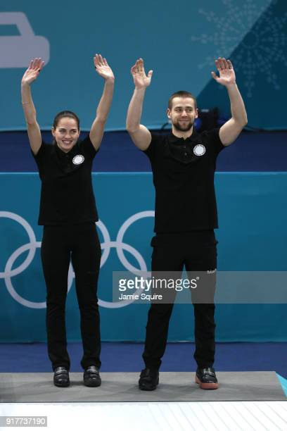 Bronze medal winners Anastasia Bryzgalova and Aleksandr Krushelnitckii of Olympic Athletes from Russia celebrate during the victory ceremony after...