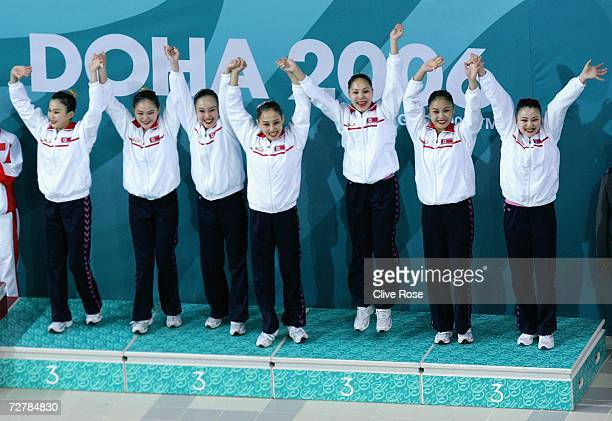 Bronze Medal winners Democratic People's Republic of Korea celebrate after winning in the Team Free Routine Synchronised Swimming Final at the 15th...