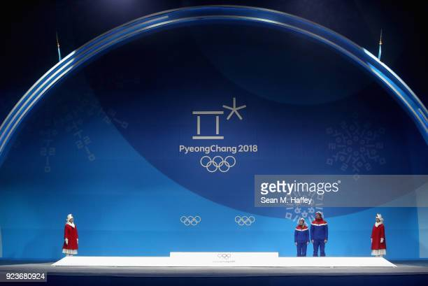 Bronze medal winners Kristin Skaslien and Magnus Nedregotten of Norway celebrate during the medal ceremony for Curling Mixed Doubles on day fifteen...
