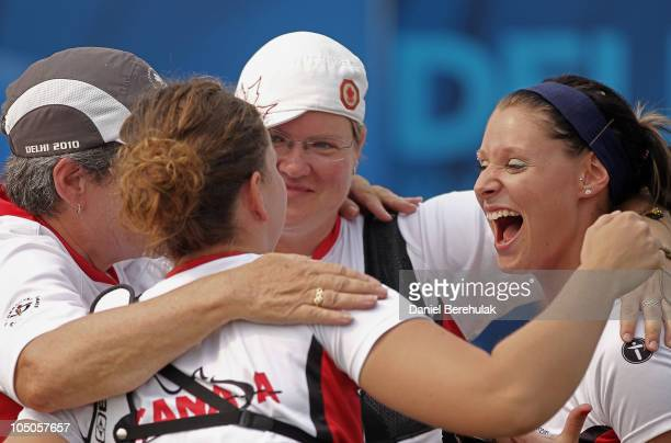 Bronze medal winners Marie-Pier Beaudet, Kateri Vrakking and Alana Macdougall of Canada celebrate with their coach Joan McDonald after the Women's...