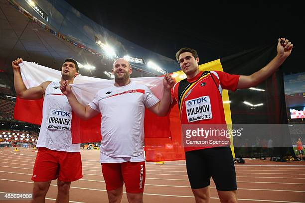 Bronze medalis Robert Urbanek of Poland, gold medalist Piotr Malachowski of Poland and silver medalist Philip Milanov of Belgium celebrate after the...