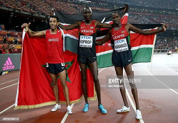 Bronze medalist Abdalaati Iguider of Morocco, gold medalist Asbel Kiprop of Kenya and silver medalist Elijah Motonei Manangoi of Kenya celebrate...