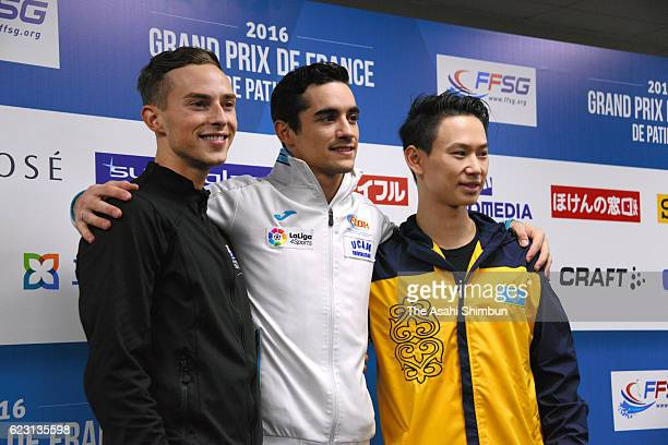 Bronze medalist Adam Rippon of the United States gold medalist Javier Fernandez of Spain and silver medalist Denis Ten of Kazakhstan pose after the...