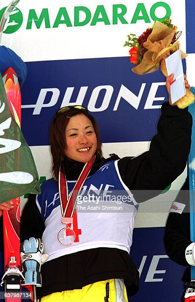 Bronze medalist Aiko Uemura of Japan celebrates on the podium at the medal ceremony for the Women's Mogul during day two of the FIS Freestyle Ski...