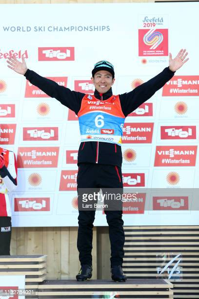 Bronze medalist Akito Watabe of Japan celebrates on the podium in the Men's Nordic Combined Individual Gundersen 10km at the 2019 FIS Nordic World...