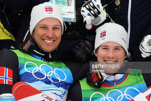 Bronze medalist Aksel Lund Svindal and silver medalist Kjetil Jansrud of Norway celebrate after their performance in the Alpine Skiing Men's Giant...