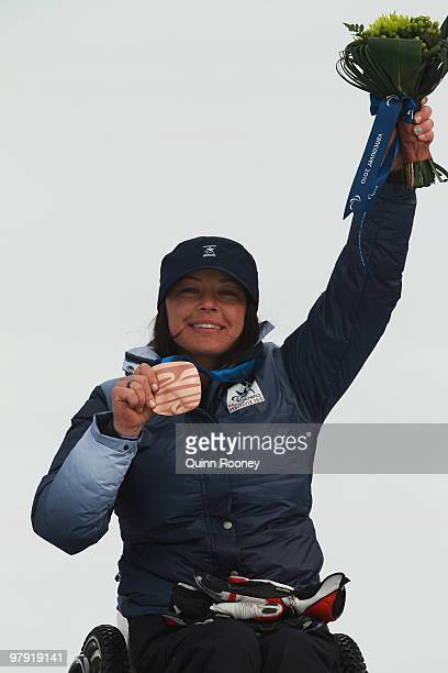 Bronze medalist Alana Nichols of USA celebrates at the medal ceremony for the Women's Sitting Super Combined during Day 9 of the 2010 Vancouver...