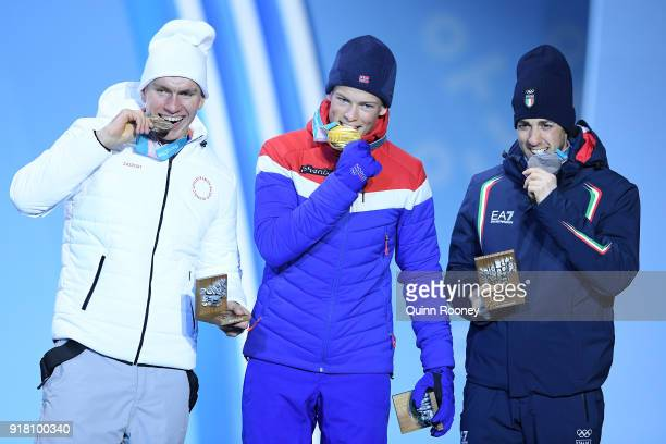 Bronze medalist Alexander Bolshunov of Olympic Athlete from Russia gold medalist Johannes Hoesflot Klaebo of Norway and Silver medalist Federico...