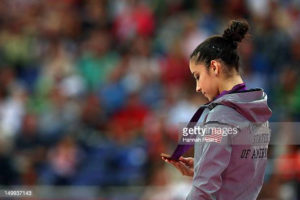 Bronze medalist Alexandra Raisman of the United States poses on the podium during the medal ceremony for the Artistic Gymnastics Women's Beam final...