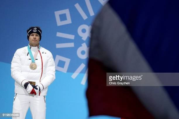 Bronze medalist Alexis Pinturault of France celebrates during the medal ceremony for the Alpine Skiing Men's Giant Slalom on day nine of the...