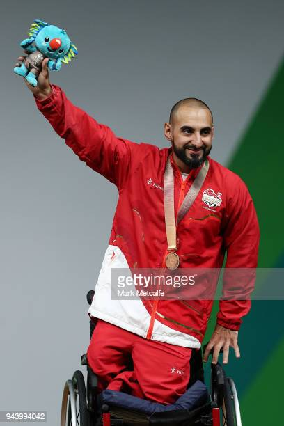 Bronze medalist Ali Jawad of England celebrates during the medal ceremony for the Para Powerlifting on day six of the Gold Coast 2018 Commonwealth...
