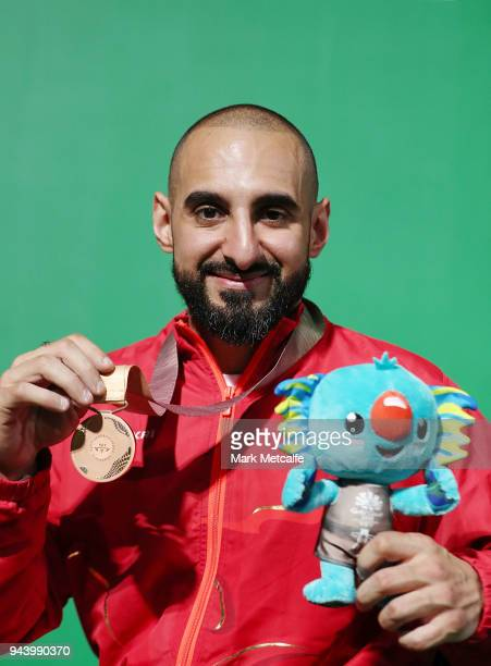 Bronze medalist Ali Jawad of England poses during the medal ceremony for the Para Powerlifting on day six of the Gold Coast 2018 Commonwealth Games...