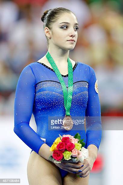 Bronze medalist Aliya Mustafina of Russia celebrates during the medal ceremony after Women's Balance Beam Final on day six of the 45th Artistic...