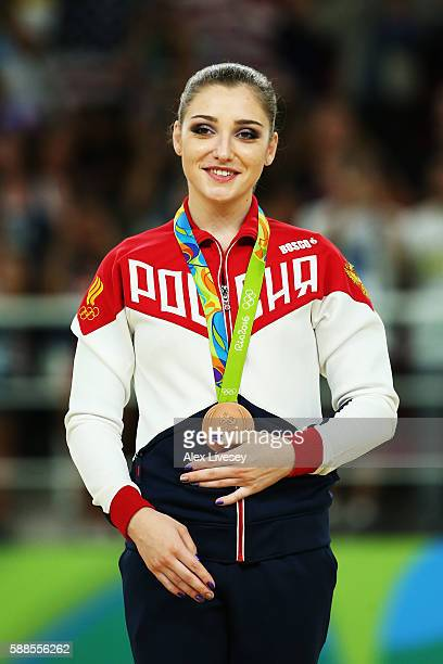 Bronze medalist Aliya Mustafina of Russia celebrates on the podium at the medal ceremony for the Women's Individual All Around Final on Day 6 of the...