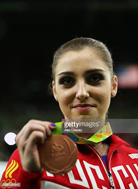 Bronze medalist Aliya Mustafina of Russia poses for photographs after the medal ceremony for the Women's Individual All Around on Day 6 of the 2016...