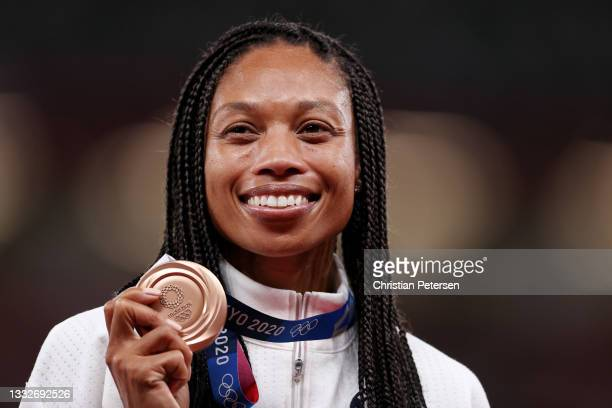 Bronze medalist Allyson Felix of Team USA holds her medal on the podium during the medal ceremony for the Women's 400m on day fourteen of the Tokyo...