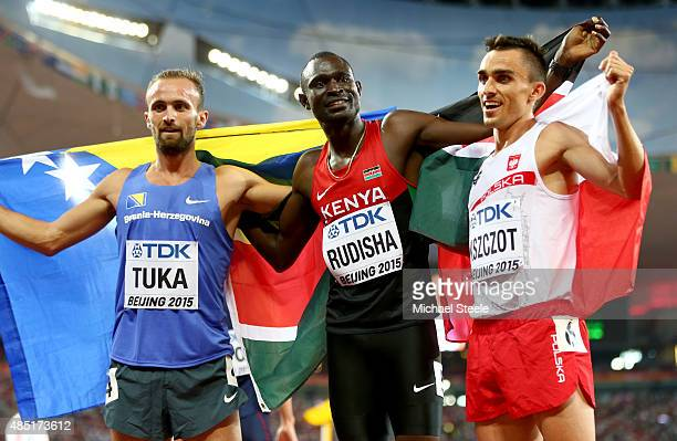 Bronze medalist Amel Tuka of Bosnia and Herzegovina gold medalist David Lekuta Rudisha of Kenya and silver medalist Adam Kszczot of Poland celebrate...