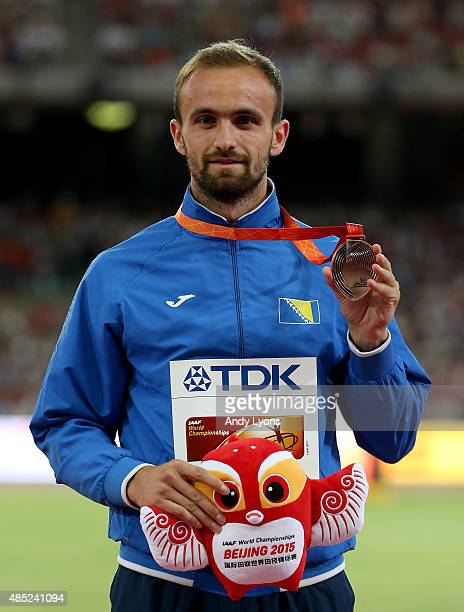 Bronze medalist Amel Tuka of Bosnia and Herzegovina poses on the podium during the medal ceremony for the Men's 800 metres during day five of the...
