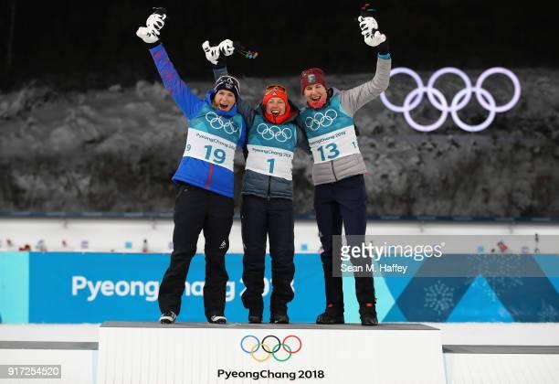 Bronze medalist Anais Bescond of France gold medalist Laura Dahlmeier of Germany and silver medalist Anastasiya Kuzmina of Slovakia celebrate during...