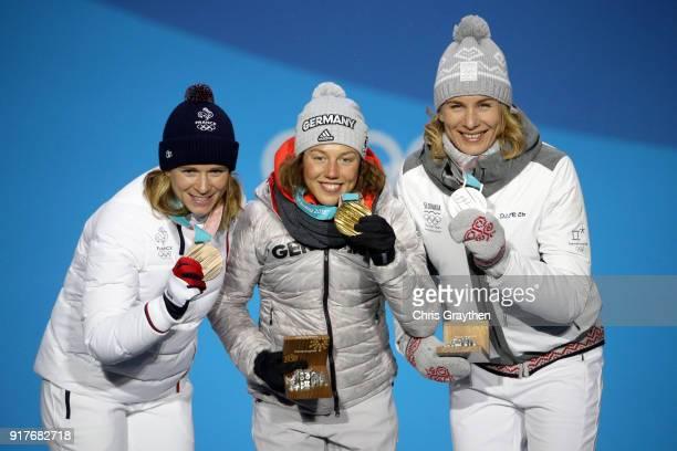 Bronze medalist Anais Bescond of France gold medalist Laura Dahlmeier of Germany and silver medalist Anastasiya Kuzmina of Slovakia pose during the...