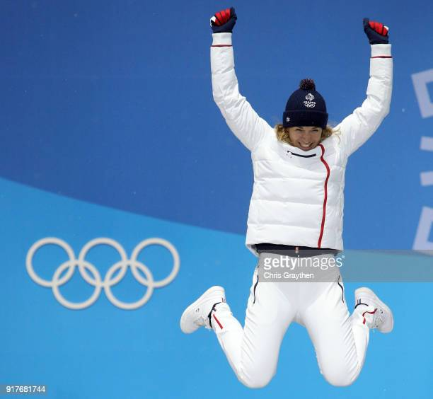 Bronze medalist Anais Bescond of France jumps during the medal ceremony after the Women's Biathlon 10km Pursuit on day four of the PyeongChang 2018...