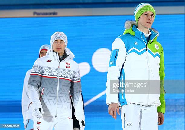 Bronze medalist Anders Bardal of Norway gold medalist Kamil Stoch of Poland and silver medalist Peter Prevc of Slovenia celebrate during the medal...